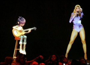 The use of live holograms as part of musical performances is not necessarily fresh, as examined in this 2006 Grammy performances featuring Madonna and the cartoon band Gorillaz.
